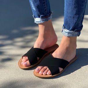 Black criss cross slip on sandal